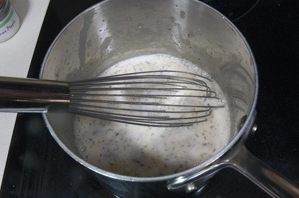Add the milk, and continue to whisk until the mixture thickens.