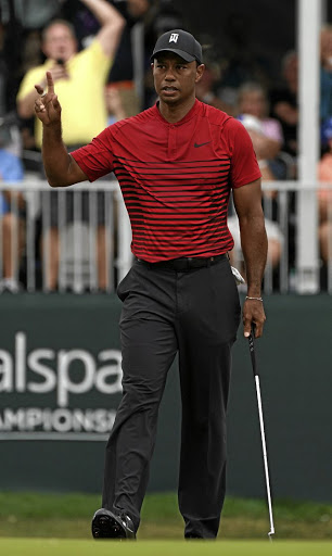 Tiger Woods acknowledges the gallery applause after making a 35-foot putt for birdie on the 17th during the final round of the Valspar Championship on Sunday. Picture: USA TODAY Sports/Jasen Vinlove