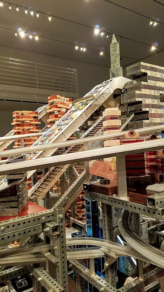If you buy your LACMA museum admission, there is another Chris Burden exhibit you can view inside one of the building Broad Contemporary Art Museum. This is Metropolis II, also a sculpture but a kinetic one. Some of the times, it is a mini city, frozen in time with a lot of Hot Wheel Cars and Miniature trains on bridges and roads throughout the multiple levels.