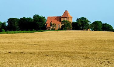 Photo: Corn fields and a village church on the Baltic coast.