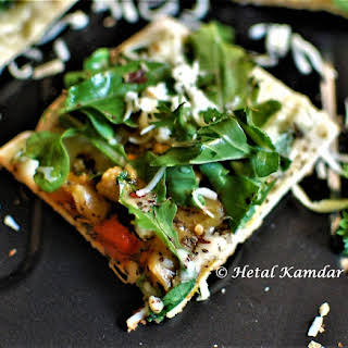 Exotic Rocket leaves and veggie tawa pizza.