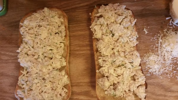 Spread mixture onto the toasted Ciabatta and top with remaining swiss cheese.