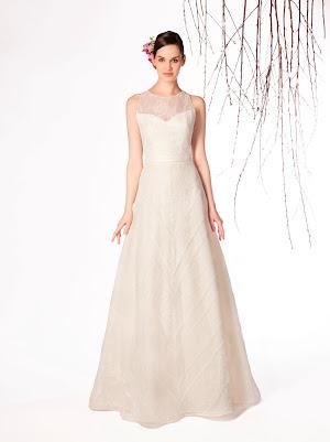Robe de mariée Eden sans manches, ave mélange de dentelles fines différentes et un joli dos nu
