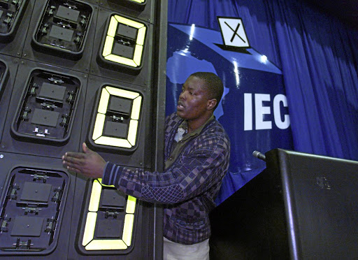 The numbers game: A technician prepares a results board at the Electoral Commission of SA headquarters in Pretoria ahead of an election in this file picture. Picture: REUTERS