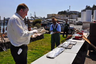 Photo: Gregory and Don, salmon wrapped in foil from the pit