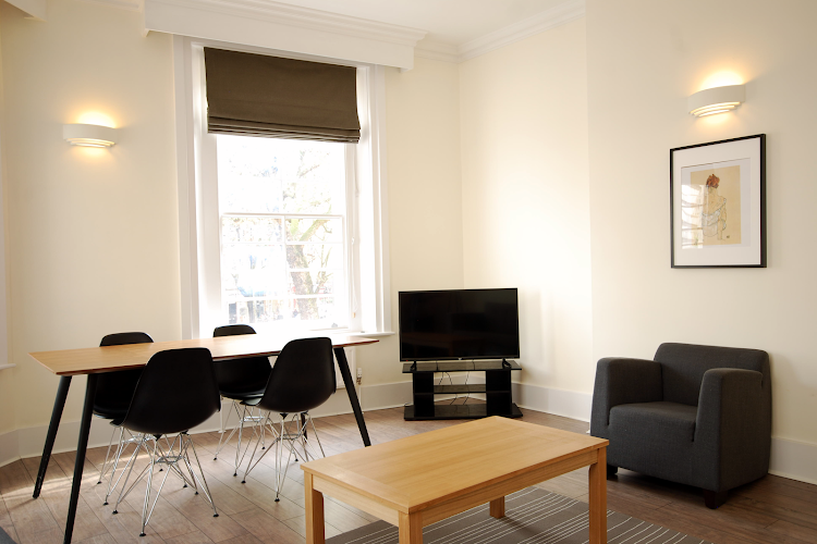 Cosy living area in Oxford Street Apartment, London