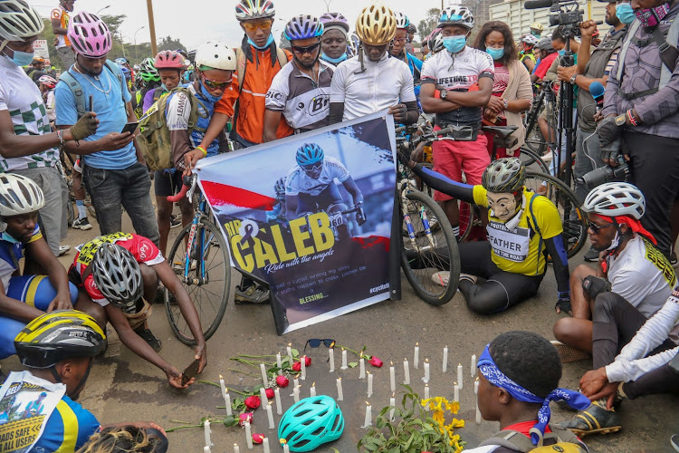 Cyclists assemble at the spot where Caleb Omwoyo died along Thika Super Highway, Nairobi on September 19, 2020