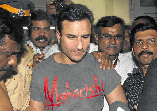 Saif Ali Khan is escorted by Mumbai police this week. The Bollywood star has been charged with assaulting two diners at the Taj Mahal Palace hotel in Mumbai.