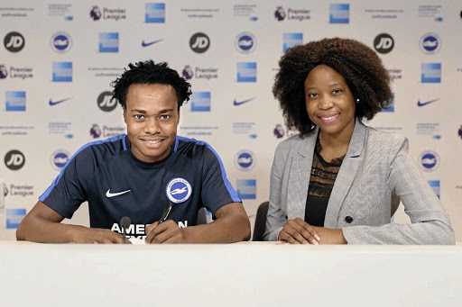 Percy Tau and his agent Mmatsatsi Sefalafala during the completion of the former Mamelodi Sundowns star's record-breaking move to English Premier League side Brighton & Hove Albion.