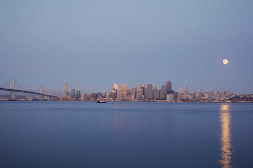 San-Francisco-skyline-in-morning - The moon shines down on the San Francisco skyline in the early morming as seen from Treasure Island.