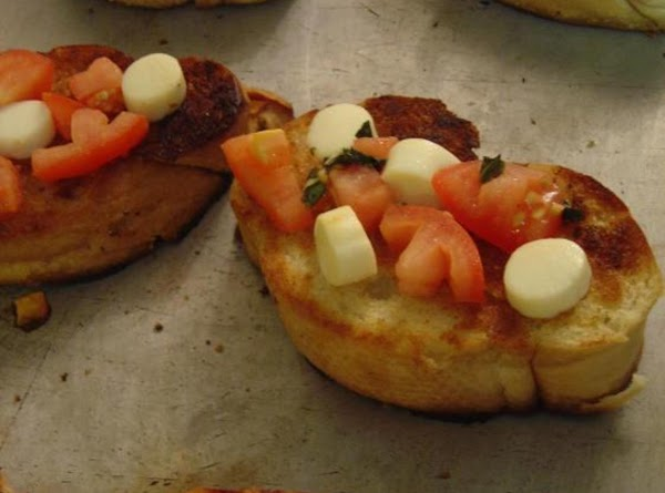 Spread 1-2 tablespoons of tomato mixture onto each slice of bread.