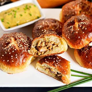 Pretzel Bao With Sweet Sesame-Hot Mustard Pork.