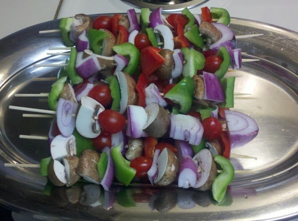 Cut veggies into roughly same size pieces, skewer alternating veggies, when all are skewered...