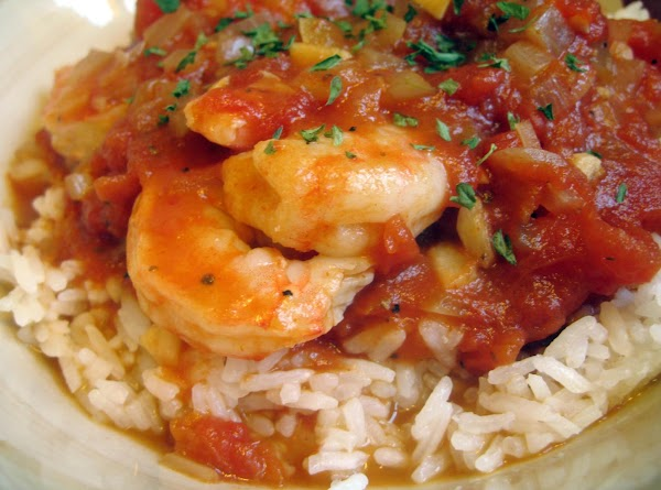 Add 2 pounds of cleaned and deveined shrimp.  Cook in Creole sauce until...