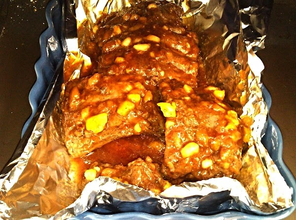 After ribs are done in crockpot, turn on oven broiler.  Place ribs in...