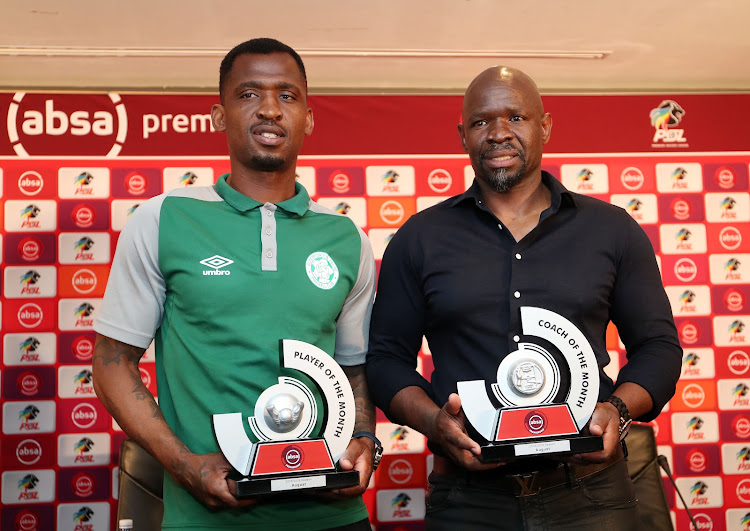 Alfred Ndengane (L) and his Bloemfontein Celtic coach Steve Komphela received their awards respectively during the Absa Premiership coach and player of the month announcement at the PSL Offices in Parktown, Johannesburg, on September 17 2018.