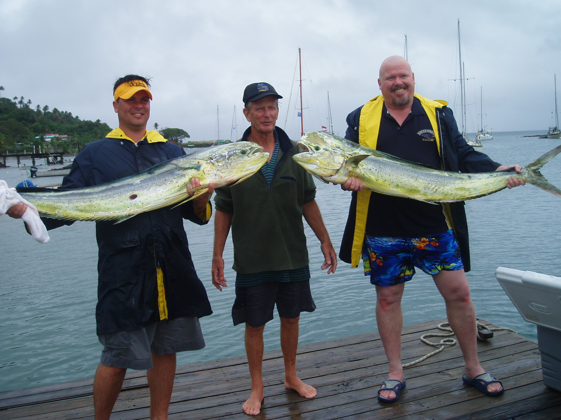 Photo: 18kg Mahimahi caught in August.    2 Happy clients.