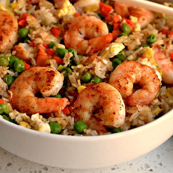 This Shrimp Fried Rice Recipes Comes Together In Less Than Thirty Minutes And Tastes So Much Better Than Takeout. I Love To Serve It With Sweet Pork Dumplings And Crab Rangoon.  Be Sure To Read My Helpful Tips On Making This Recipe.