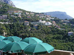 Photo: A final view from lower in the village, over some cafe umbrellas to the surrounding hillside.