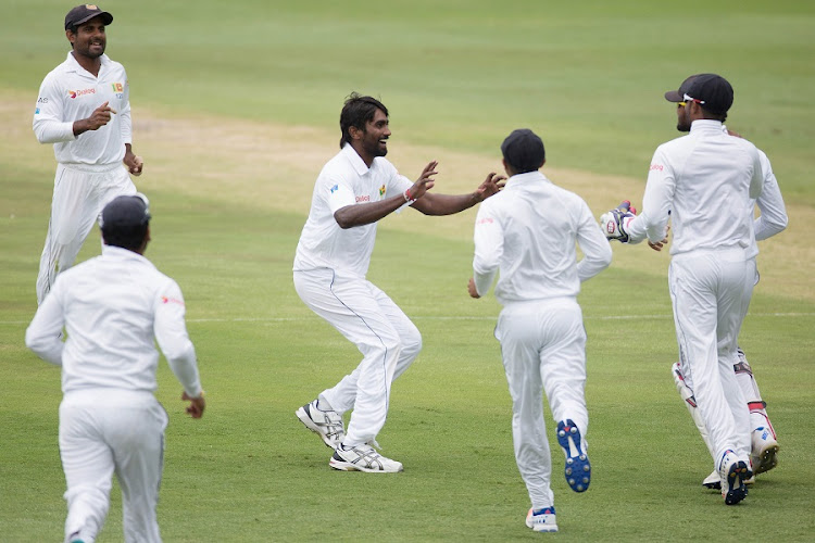 Sri Lanka celebrates the wicket of South Africa's Hashim Amla. Picture: REUTERS/JAMES OATWAY