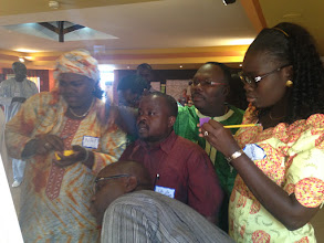 Photo: Participants work on their Designing for Behavior Change frameworks during the recent training in Dakar, Senegal offered by The TOPS Program.