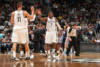 Photo: Joe Johnson #7 of the Brooklyn Nets slaps hands with members of his team during a timeout against the Denver Nuggets at the Barclays Center on February 13, 2013 in Brooklyn, NY.