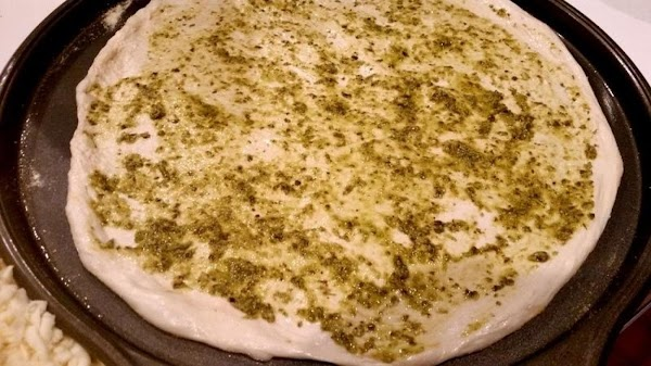 On a pizza pan, I use teflon coated, spread 1/2 tablespoon olive oil with...