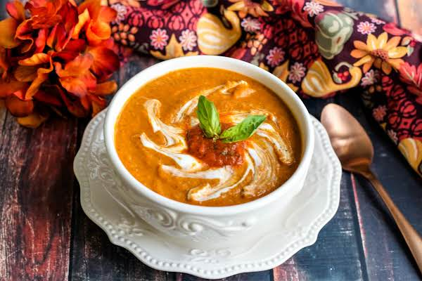 Savory Roasted Butternut Squash & Roasted Red Pepper Soup In A Bowl.
