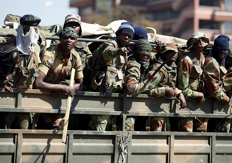 Members of the military gesture as they patrol the streets of the capital Harare, Zimbabwe, August 2 2018. Picture: REUTERS