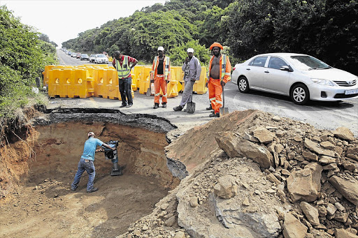 Road construction workers in a race against time to repair a large sinkhole that has caused traffic snarl-ups on the road between Umdloti and Umhlanga, two of KwaZulu-Natal's popular tourist destinations.