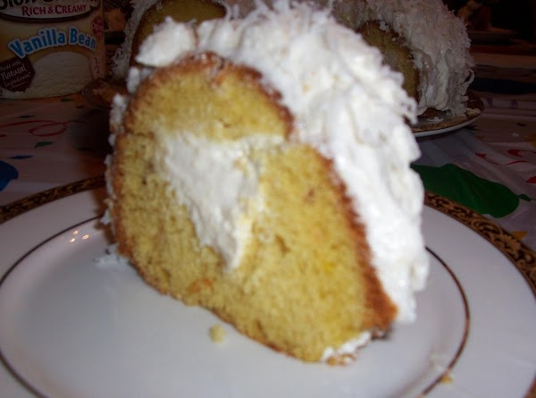 """Preheat oven to 350 degrees F. Grease and flour a 10"""" Bundt or tube pan."""