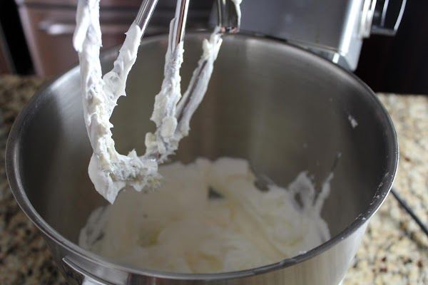 In the bowl of your stand mixer beat the cream cheese until fluffy. ...