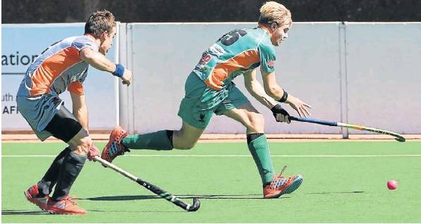 St Andrew's player Peter Jarvis, right, goes on the attack during a Premier Hockey League match in August in Johannesburg