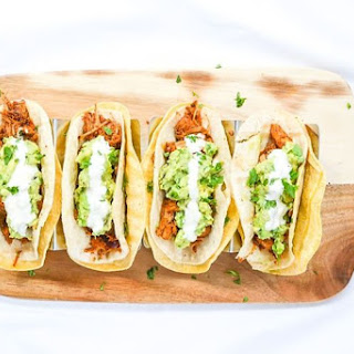 CHIPOTLE JACKFRUIT TACOS WITH SIMPLE GUAC AND LEMON ORANGE CREMA.