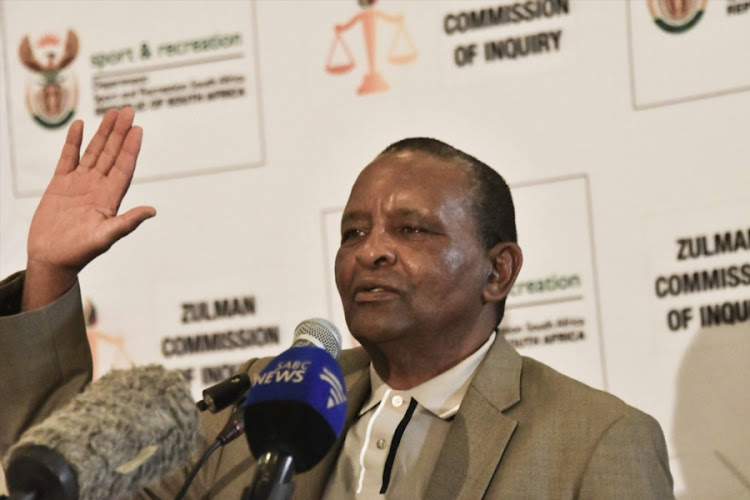 Sascoc embattled president Gideon Sam raises his right hand during his testimony at the Ministerial Committee of Inquiry at Ellis Park Stadium Auditorium on March 14, 2018 in Johannesburg, South Africa.