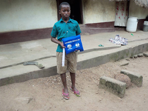 Photo: Recipient with Universal Braille Kit