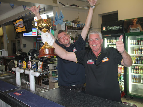 The Tourist Hotel's Chris McGrath and Graham Richardson pose with the Melbourne Cup yesterday.
