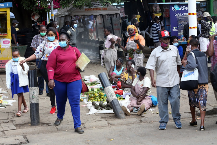 Hawkers returned to the streets jostling for space with pedestrians at the Kencom Stage in Nairobi on May 6, 2020.