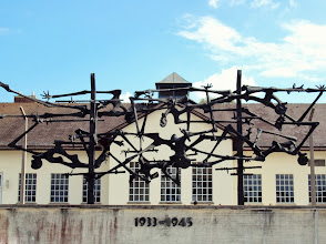 "Photo: ""Dachau Memorial"" Dachau Concentration Camp, Germany Anna Hartmann  2nd Place, Iconic Images  This memorial honors the desperate prisoners that committed suicide by jumping into the barbed wire surrounding the concentration camp. The sculpture depicts my experience at Dachau: both overwhelmingly emotional and startling"
