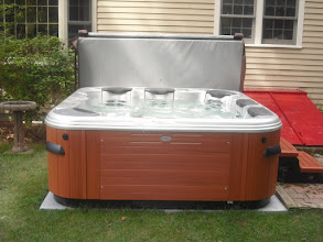 Photo: We ordered an EZ Pad because we expected it would be a simple way to provide a sturdy, flat, level surface for the hot tub we'd ordered. Boy, were we right! Once the ground was flattened and leveled, the 4' square sections were easily assembled and the EZ Pad was placed in position. The hot tub has been installed for 3 months now and gets regular use. The tub remains level and there has been no shifting of tub or pad. We would definitely recommend others use the EZ Pad for their tubs.  Regards,  - Laura