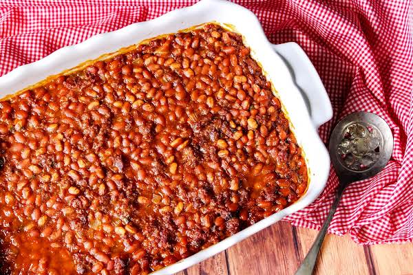 A Dish Filled With Southern Sausage Baked Beans.