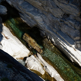Ponte Brolla, Ticino, Switzerland by Serguei Ouklonski - Nature Up Close Rock & Stone ( rock - object, formation, geology, high angle view, summer, rock, creek, stream, flowing water, day, flow, no person, travel destinations, solid, motion, nature, switzerland, beauty in nature, water, physical geography, flowing, stone, environment, eroded, rock formation, ticino, outdoors, tranquility, river, travel, scenics - nature, no people, wild, non-urban scene, landscape, nature landscape )