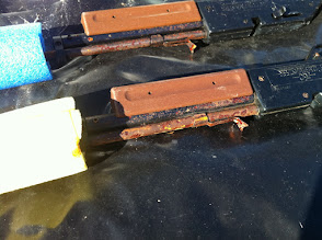 Photo: Rusted BB guns; left one week in wet trash can