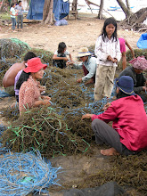 Photo: locals cleaning their nets in a fishing village in the Kampot region