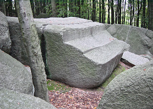 "Photo: The socalled Altarstein (altar stone) made from Diorite,  length about 3m with saw cuts made with a blade at maximum thickness of 2mm. In my opinion, all the work on the Felsberg have been done at a time when the granite was ""new"" and not completely hardened yet, in a state like wet clay. I know, that this contradicts the classic theory about granite formation, but I don't see any other reasonable logical explanation so far.  There is a new well designed and informative visitor centre at the foot of the Felsberg: http://www.felsenmeer-informationszentrum.de/  Location: Felsberg, Odenwald, Germany."