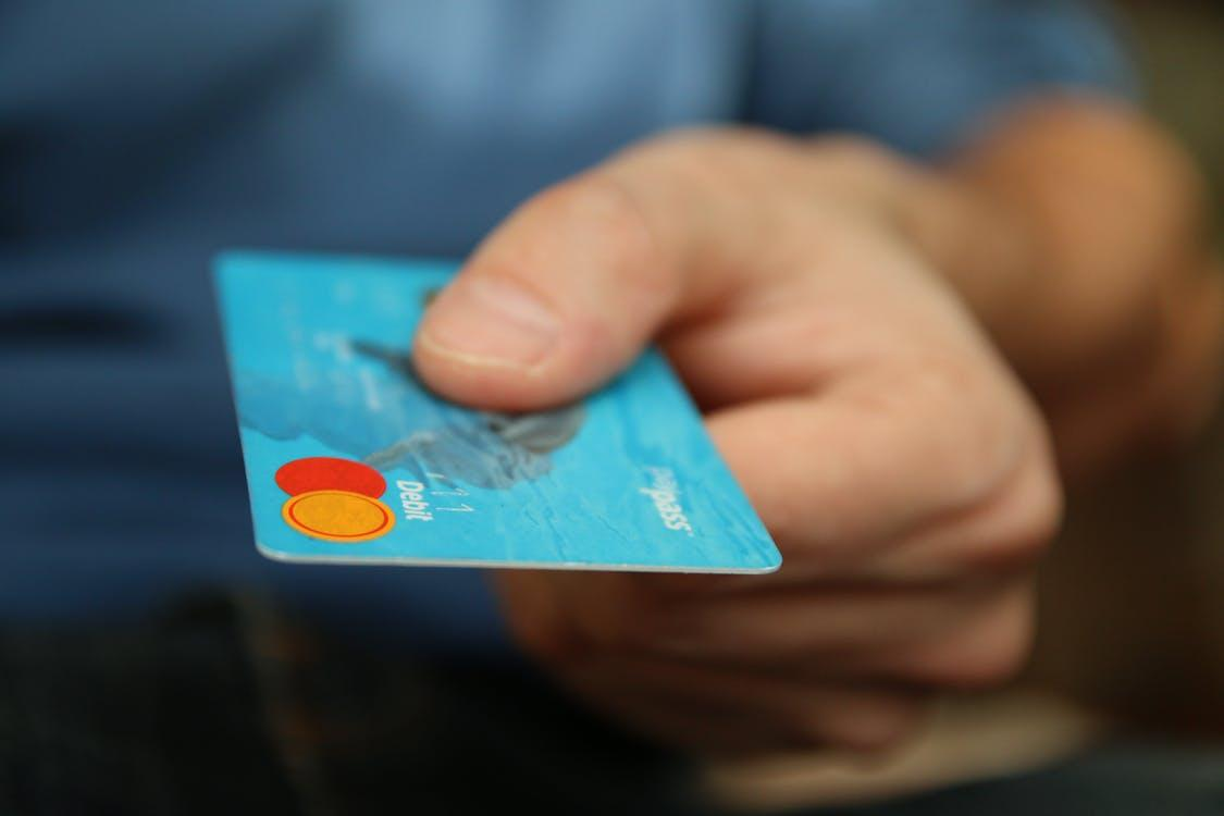 Person Holding Debit Card