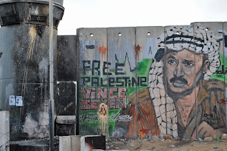 Photo: A mural of the late PLO leader Yasser Arafat outside Qalandiya checkpoint, near the city of Ramallah.
