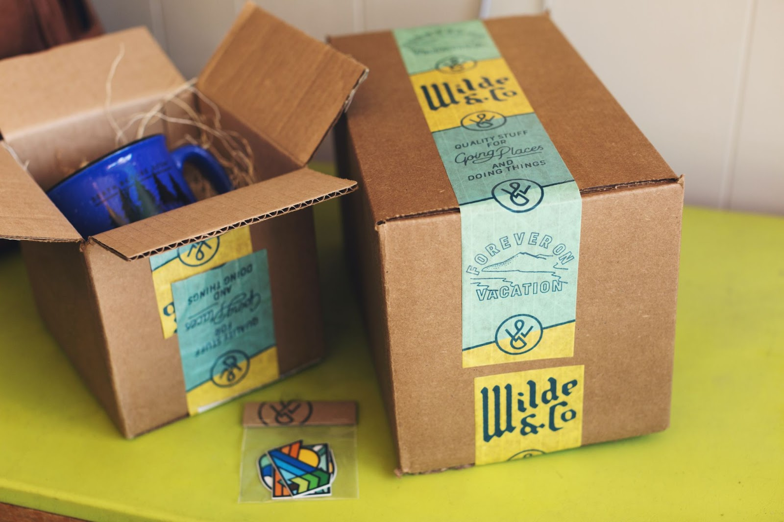 2 shipping boxes with custom branded printing tape