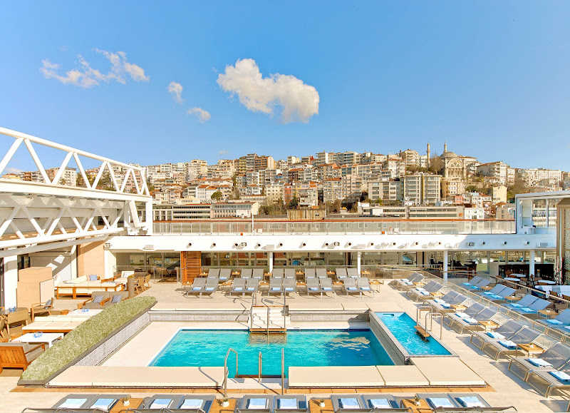 In sunny weather, the roof over the main pool on Viking Star can be opened to let the sun shine.