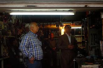 Photo: Men watching the news after the blast in Ainkawa, Erbil, Tairawa, 17.04.2015